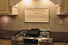 Colonial Flower Installed in Kitchen from Andersen Ceramics