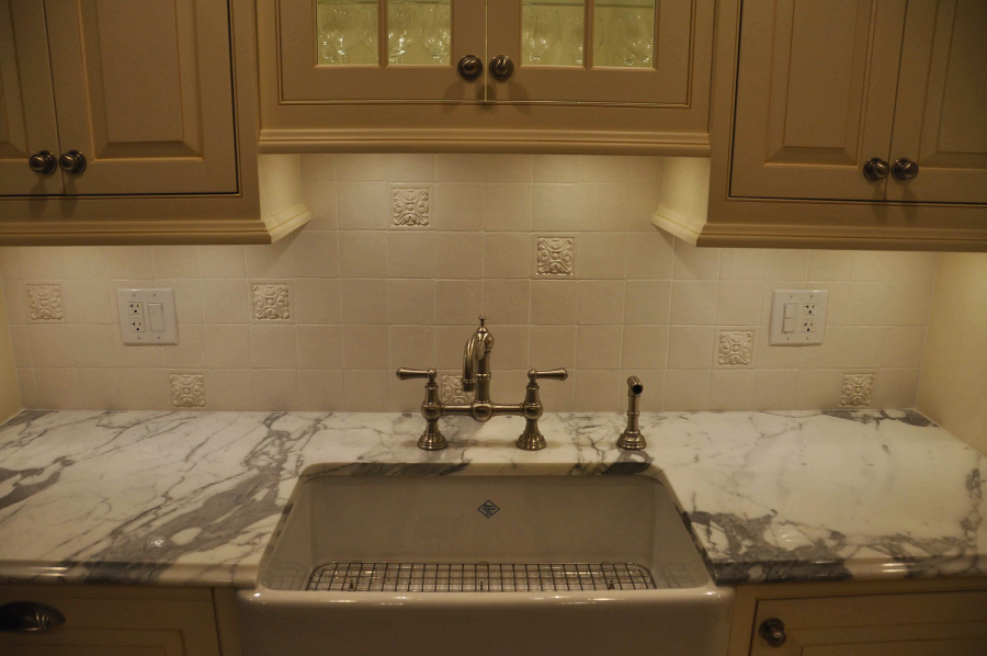 our very white flat tiles and medium medallions were used on three