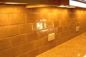 Field Tiles installed to Create Decorative Kitchen Backslash