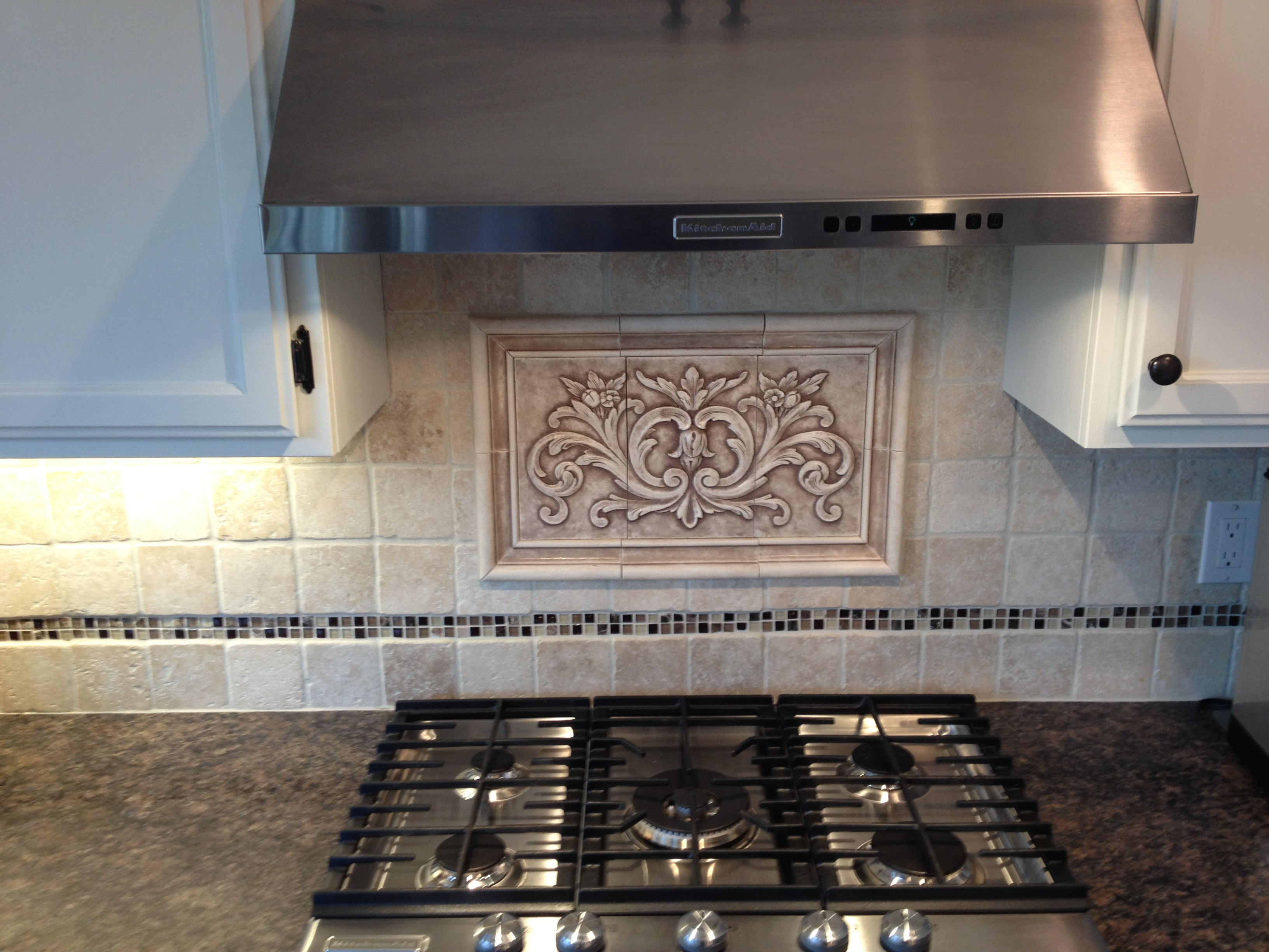 Hand pressed floral tiles installed in kitchen backsplash f pf photo dailygadgetfo Gallery