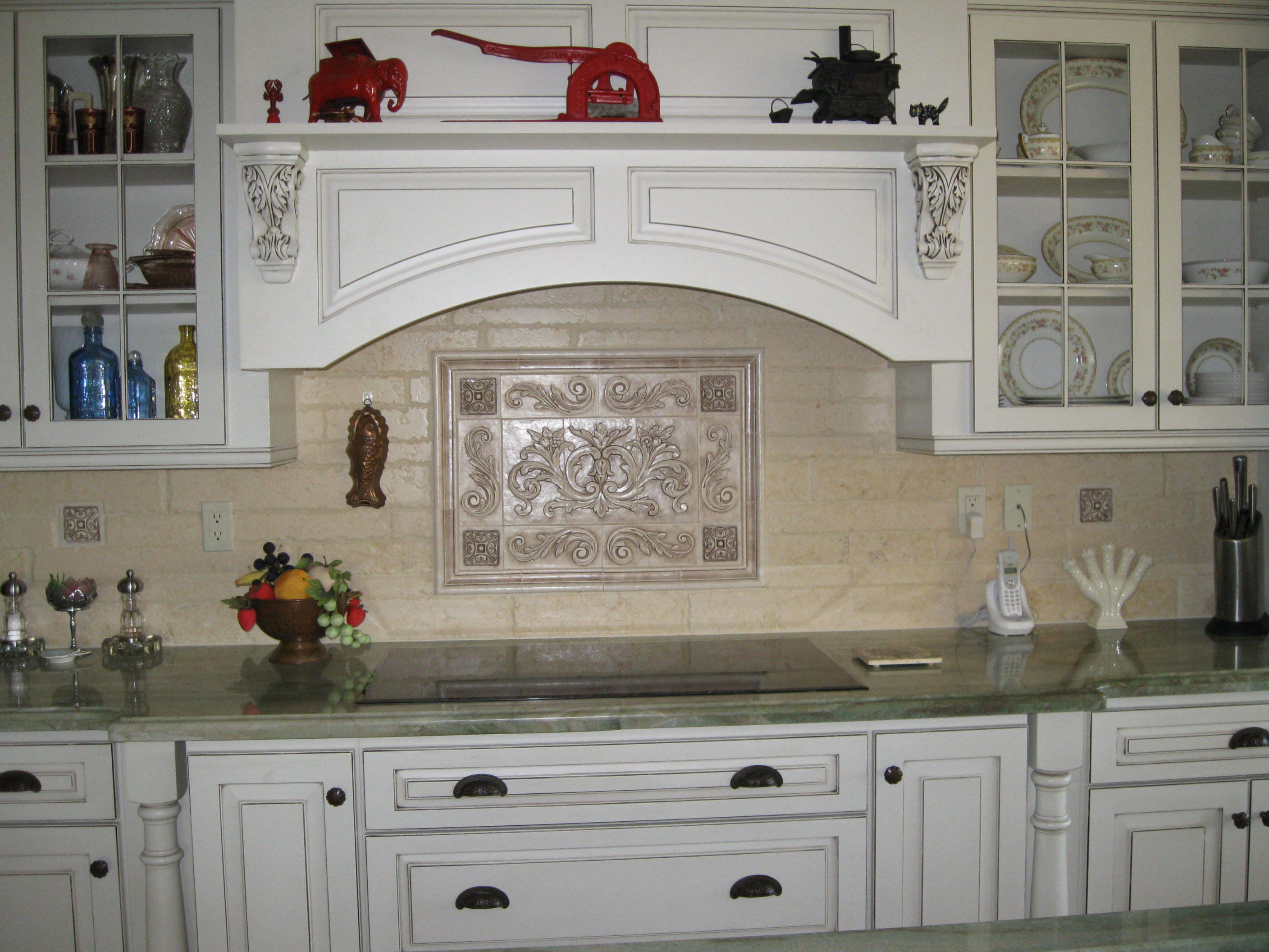 Hand pressed Floral tiles installed in kitchen backsplash